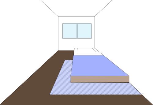 ベッドをラグの上に半分乗せる