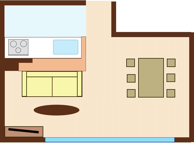 対面キッチンの腰壁を背にソファをレイアウト