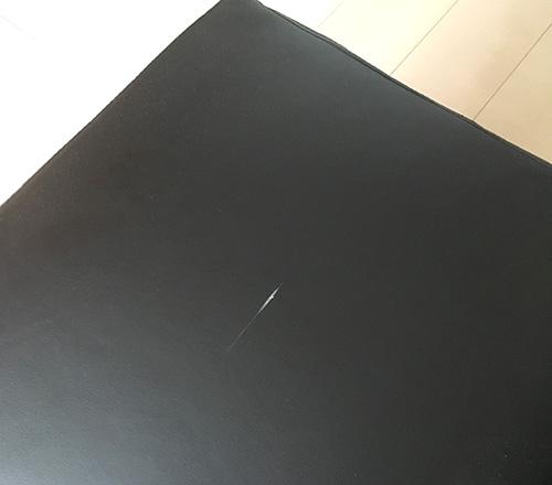 ○トリの黒のレザー製オットマン